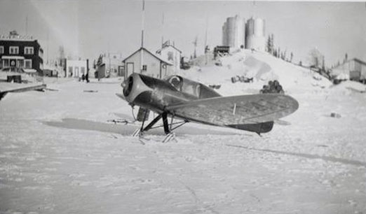 plane on skis in front of Goldfields, SK, mid 1930s